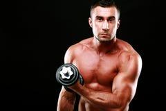 Sportsman lifting dumbbell Stock Image
