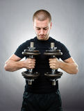 Sportsman lifting dumbbells Royalty Free Stock Photo