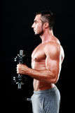 Sportsman lifting dumbbells Royalty Free Stock Photography