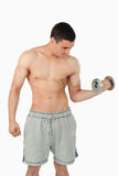 Sportsman lifting weights Royalty Free Stock Photos