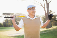 Sportsman looking away with his golf club. On a field royalty free stock photos