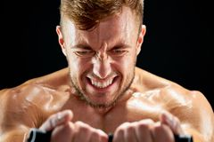 Sportsman making maximum efforts. While training. Facial expressions show how painful and hard moves are. Endurance and persistence Royalty Free Stock Images