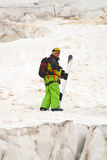 Sportsman in the mountains. Sportsman in Caucasus mountains with snowboard Royalty Free Stock Photo