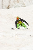 Sportsman in the mountains. Sportsman in Caucasus mountains with snowboard Stock Photography