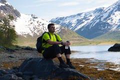 Sportsman on mountains lake Stock Images
