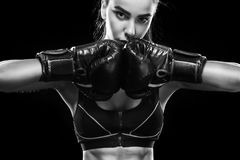 Sportsman muay thai boxer fighting. Isolated on black background. Copy Space. Sport concept. Street fighter female isolated on black background with copy Space Stock Images