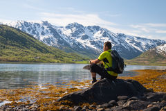 Sportsman near mountain lake Stock Photo