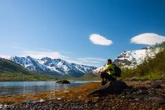 Sportsman near mountain lake Stock Photos