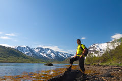 Sportsman near mountain lake Stock Image