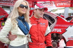 Sportsman Novikov with woman and car Royalty Free Stock Photos
