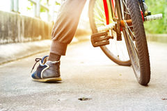 Sportsman and old bicycle on street in summer, colorful and soft focus Stock Photos