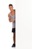Sportsman Peeking Behind Banner Royalty Free Stock Image