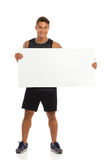 Sportsman With A Placard Royalty Free Stock Photography