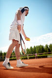 Sportsman play's tennis. In tennis court Royalty Free Stock Photos