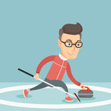 Sportsman playing curling on on a skating rink. Stock Photo
