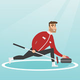 Sportsman playing curling on a skating rink. Royalty Free Stock Image