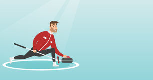 Sportsman playing curling on a skating rink. Stock Photography