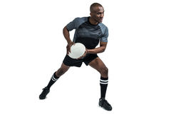 Sportsman in position to throw rugby ball Royalty Free Stock Photography