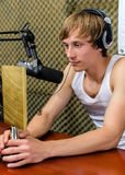 Sportsman on the radio. Sportsman with a prize on the radio station Stock Image