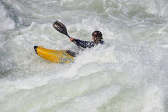 Sportsman on the rapids Stock Photos