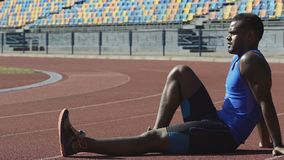 Sportsman resting on racetrack observing training of competitors, exercising stock video