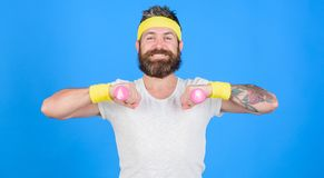Sportsman retro outfit training blue background. Athlete on way to strong body. Healthy habits. Athlete amateur workout. Athlete training with little dumbbell stock photography
