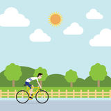 The sportsman is riding bicycle to farm Royalty Free Stock Image