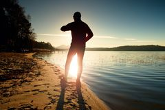 Sportsman  running at amazing summer sunset at the beach  in sport and healthy lifestyle concept Royalty Free Stock Images