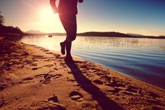 Sportsman  running at amazing summer sunset at the beach  in sport and healthy lifestyle concept Royalty Free Stock Photography