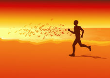 Sportsman running on the beach in the sunset Royalty Free Stock Images