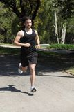 Sportsman running on a park Stock Photography