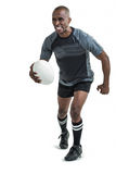 Sportsman running while playing rugby Stock Photography