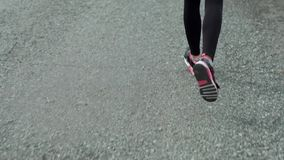 Sportsman running on the road stock footage