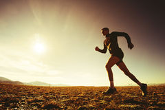 Sportsman running on the sky nature concept stock image