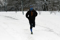 A sportsman runs on snow stock images
