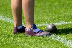 Sportsman in shot put sector on competition.  stock image