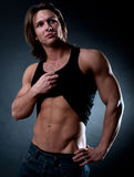 Sportsman showing abdominal muscles Royalty Free Stock Image