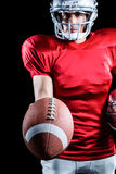 Sportsman showing American football Royalty Free Stock Photography