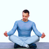 Sportsman sitting in the lotus position Stock Photos