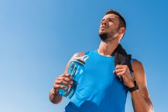 Sportsman with towel and sport bottle Royalty Free Stock Image