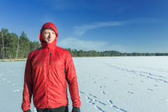 Sportsman at snowy winter outdoor landscape background in protective nylon jacket Stock Photography