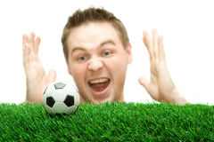 Sportsman or soccer fan screaming on the ball. On the grass Royalty Free Stock Photos