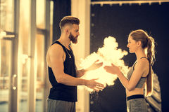Sportsman and sportswoman with chalk powder standing in sports center stock photography