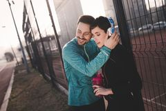 Sportsman and sportswoman flirting outdoor after fitness exercis Stock Photo