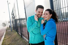 Sportsman and sportswoman flirting outdoor after fitness exercis Royalty Free Stock Images