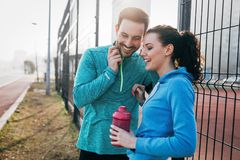 Sportsman and sportswoman flirting outdoor after fitness exercis Stock Photos
