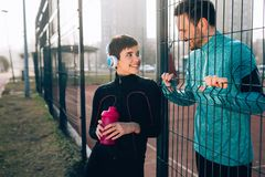 Sportsman and sportswoman flirting outdoor after fitness exercis Stock Photography