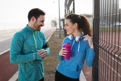 Sportsman and sportswoman flirting outdoor after fitness exercis Royalty Free Stock Image