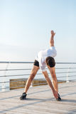 Sportsman standing and doing exercises in the morning Royalty Free Stock Photo