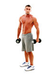 Sportsman  standing  with dumbbells Stock Photos